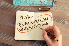 Handwritten text ASK EVALUATION QUESTIONS - stock photo