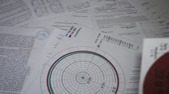 Documents are scattered on the table Stock Footage