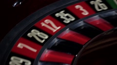 Usual roulette wheel running with fallen white ball, close up Stock Footage