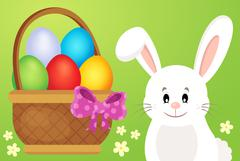 Basket with eggs and Easter bunny - eps10 vector illustration. Stock Illustration