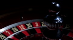 Roulette wheel running and stops with white ball on 20 Stock Footage
