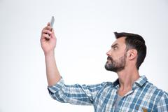 Man searching connection on the phone - stock photo