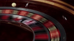 One part of roulette wheel running, white ball falls - stock footage
