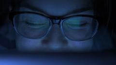 Woman look at computer screen at night Stock Footage