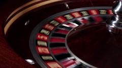 One part of fast running usual wheel roulette, white ball falls on 22, close up Stock Footage