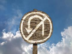 Crude Hand-Painted No U-Turn Sign on Old Round Wooden Signpost - stock illustration