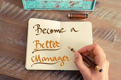 Stock Photo of Handwritten text BECOME A BETTER MANAGER