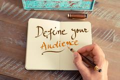 Handwritten text DEFINE YOUR AUDIENCE - stock photo