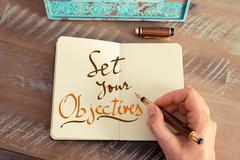 Handwritten text SET YOUR OBJECTIVES Stock Photos