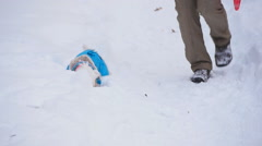 Dog retrieving a toy in snow Stock Footage