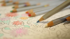 Drawing with pencil at home an Adult coloring book Stock Footage