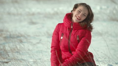 Beautiful, pretty girl sitting in the snow Stock Footage