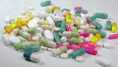 Big stack of medicine, pills, tablets in wrap on white background - zoom in Stock Footage
