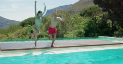 Happy couple jumping in the pool Stock Footage