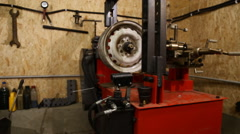 Tire fitting station equipment Stock Footage