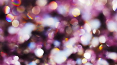 Abstract color bokeh circles background in violet tones - stock footage