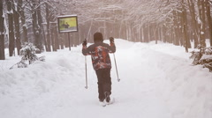 Baby is skiing in winter Park, snow day Stock Footage