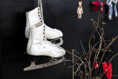 Old skates  hanging on the laces Stock Photos