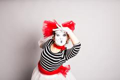 Portrait of a comedian  woman dressed up as a mime, April Fools Day concept - stock photo