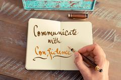 Handwritten text COMMUNICATE WITH CONFIDENCE - stock photo