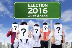 Unknown people with election board - stock photo