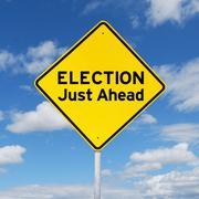 Yellow signboard toward election - stock photo