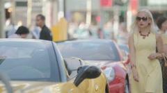 Beautiful woman in dress near the car Stock Footage