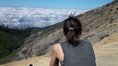 Woman admire beautiful view on clouds during trekking - stock footage