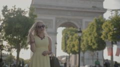 Charming blonde posing near the Arc de Triomphe in Paris - stock footage