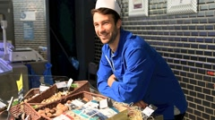 Portrait of smiling fishmonger in uniform Stock Footage