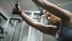 Young pretty female working out her triceps in the gym, in slow motion - stock footage