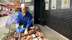 Fishmonger woman serving seafood - stock footage