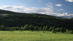 Panorama over picturesque meadows and moody sky Stock Footage