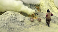 Ijen volcano crater, workers dig sulfur in extreme conditions, slow motion Stock Footage