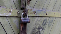 Old padlock on the door of the shed. - stock footage