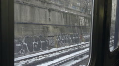 Window view of graffiti on subway riding on B train in winter snow NYC Stock Footage