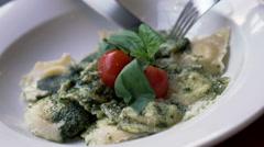 Man eating gnocchi pasta in restaurant Stock Footage