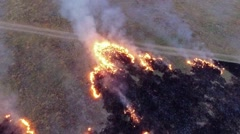 AERIAL VIEW. Burning Dry Grass In The Field Of Steppe Zone Stock Footage