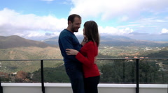 Young couple dancing on terrace with country mountains view, super slow motion Stock Footage