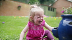 4K Tears & tantrums - Portrait of little girl crying in the garden - stock footage