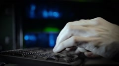 Hackerhand using computer with data code - stock footage