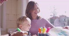 Two attractive white parents spending time with their two kids - stock footage