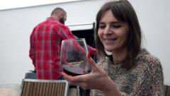 Happy woman mixing wine her boyfriend preparing grill, super slow motion Stock Footage