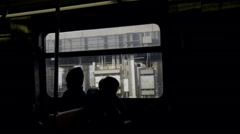 Silhouette of people on subway train riding Brooklyn sitting by window NYC Stock Footage