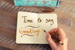 Handwritten text TIME TO SAY GOODBYE Stock Photos