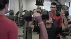 Man lifting weights with a spotter. Stock Footage
