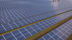 Aerial drone footage drifting over UK solar panel farm - stock footage
