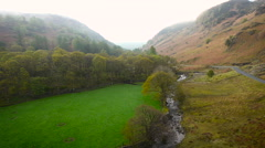 Aerial drone footage of a stream running through the Lake District, UK - stock footage