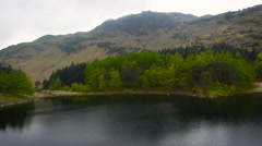 Aerial drone shot of the Lake District mountains reflected in the lake Stock Footage