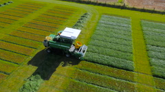 Aerial drone footage of a combine collecting grass Stock Footage